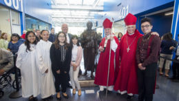 CRSM President Preston Kendall, Cardinal Blase Cupich, Bishop George Rassas together with CRSM students. /Photo: Courtesy CRSM