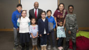 Secretary White and Waukegan Public Library reference assistant Diana Wence with some of the children who participated in the event. /Photo: Coutesy Colleen Erbach/ISS