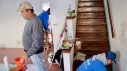 Volunteers making repairs. /Photo: Courtesy CAPOLC