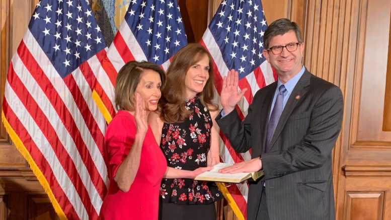 """""""Taking the oath of office on January 3 with Speaker Pelosi and my wife Julie."""" Schneider. /Photo: Courtesy B. Schneider"""