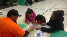 Families learn on-the-go math games that relate to their student's math curriculum in school. /Photo: Courtesy ZSD6