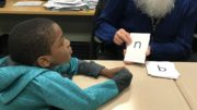 Caption: MTSS team member, Leon Grubb, works with a student to help develop grade-level skills. /Photo: Courtesy ZSD6